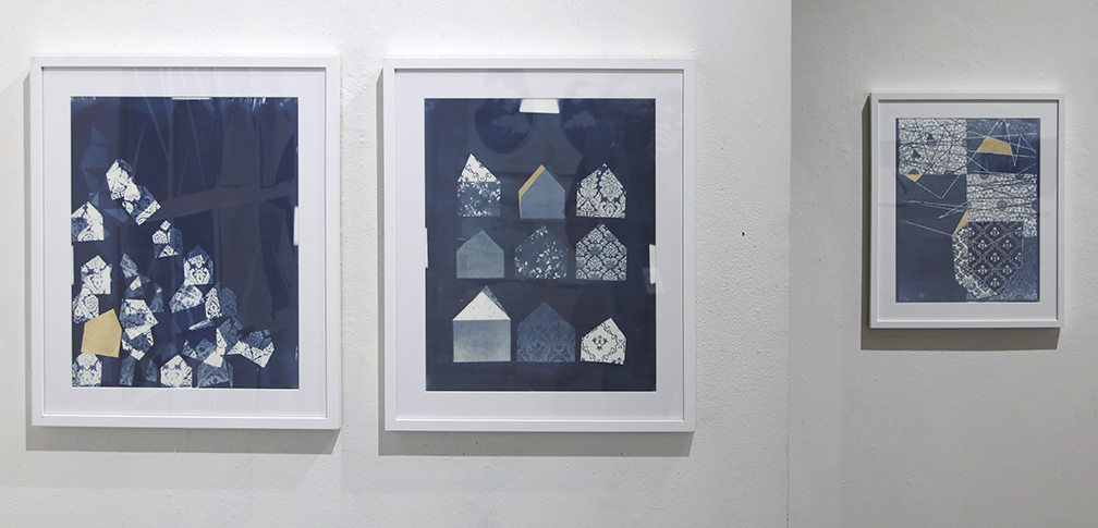 partial installation with three Brianna Burnett cyanotypes.
